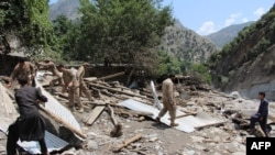 Pakistani Army personnel help villagers after their house was destroyed by flash flooding in Ursoon village in Chitral earlier this month. At least 55 people have been killed since the beginning of July due to flooding, according to Pakistan's National Disaster Management Authority.