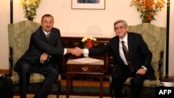 Armenian President Serzh Sarkisian (right) shakes hands with his Azerbaijani counterpart, Ilham Aliyev, during a meeting in Chisinau in October 2009.