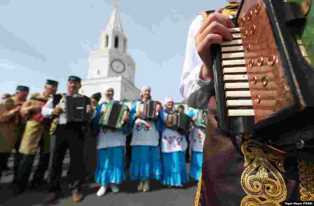 Performers during the celebration in Kazan dance and play music.