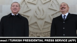Turkish President Recep Tayyip Erdogan (left) and Azerbaijani President Ilham Aliyev attending a military parade in Baku on December 10