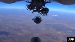 تصویر برگفته از دوربین زیرین یک هواپیمای روسی، در حال فروریختن بمب در سوریه/ منتشر شده توسط وزارت دفاع روسیه