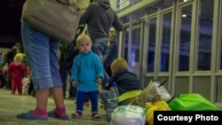Ukrainian refugees arrive in the Siberian city of Magadan on August 26.