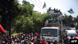 Supporters of Pakistani cricketer-turned-politician Imran Khan.