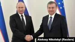 Президенты Узбекистана и России Владимир Путин и Шавкат Мирзияев.