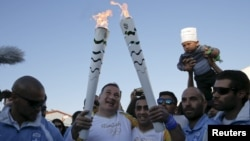 Біженець із Сирії проніс олімпійський вогонь Афінами