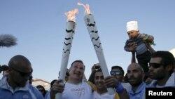 Беженец из Сирии пронес Олимпийский факел по Афинам