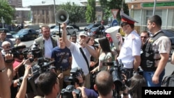 Armenia - Activists protest outside the Public Services Regulatory Commission against a 10 percent increase in electricity prices, Yerevan, 1Jul2014.