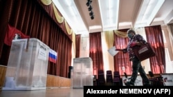 A woman casts her ballot during early voting at a polling station in Moscow on June 29.