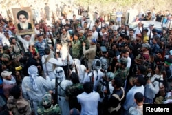 """""""Ирак және Левант ислам мемлекеті"""" ұйымына қарсы соғысқа аттанған шиит жауынгерлер. Ирак, 16 маусым 2014 жыл."""