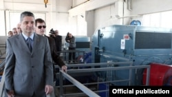 Armenia - Prime Minister Tigran Sarkisian (L) and Patrick Fine, vice-president of the U.S. Millennium Challenge Corporation, visit a newly constructed pumping station in Ararat province, 3Oct2011.