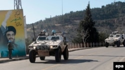 UN peacekeepers patrol near the Lebanese-Israeli border.