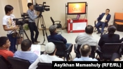 """Касым Аманжолов, журналист телеканала """"Тан"""". Алматы, 18 сентября 2014 года."""