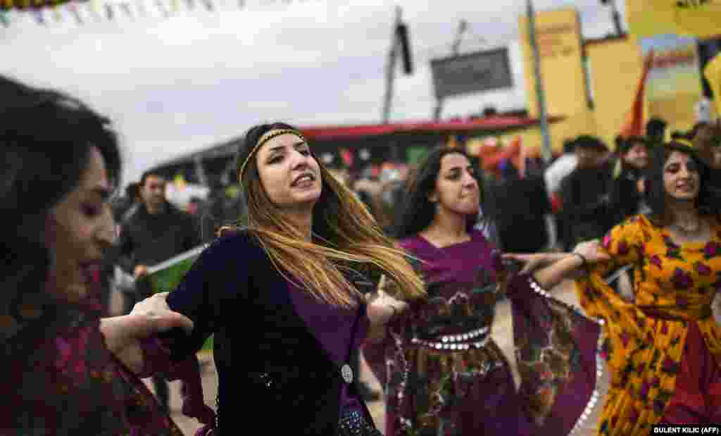 Kurdish women dance during Norouz celebrations in Diyarbakir, southeastern Turkey, on March 21.