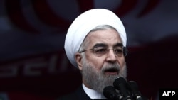 Iranian President Hassan Rohani delivers a speech on Tehran's Freedom Square to mark the 36th anniversary of the Islamic Revolution on February 11.