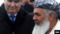 File photo of Ismail Khan with a Tajik official.