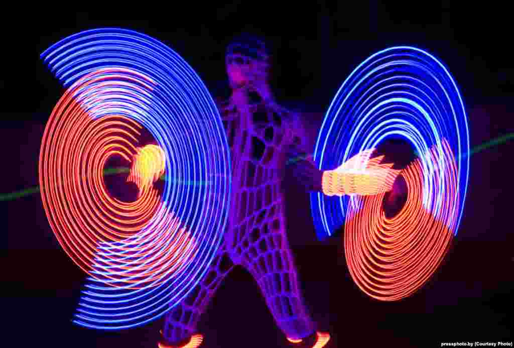 Performers at a neon show in Minsk. Photo by Natallya Ablazhey