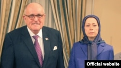 Maryam Rajavi, leader of the Iranian opposition group Mujahedin-e Khalq Organization (MKO) with former NY Mayor Rudy Giuliani.