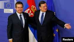 Serbian Prime Minister Ivica Dacic (left) was welcomed by European Commission President Jose Manuel Barroso ahead of a meeting at EC headquarters in Brussels on January 21.