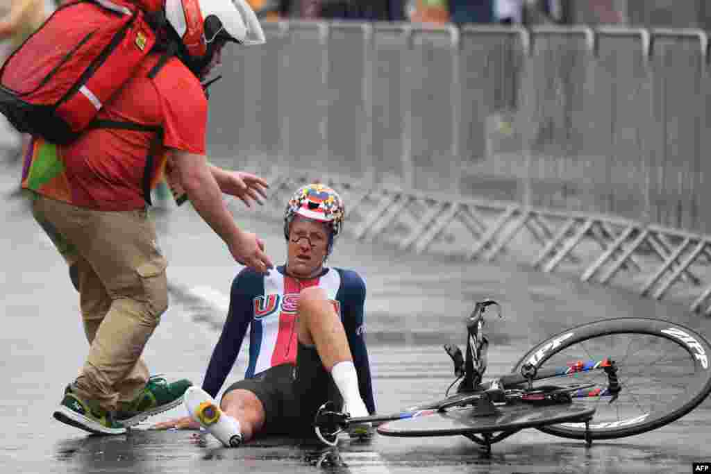 U.S. cyclist Kristin Armstrong falls after finishing the women's individual time trial event.