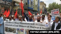 FILE: Coal miners protest against the poor working conditions after a coal mine collapsed in Pakistan's Balochistan province in May.