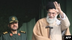 Is Supreme Leader Ayatollah Ali Khamenei (right) simply a pawn of the Revolutionary Guard, and its commander, General Mohammad Ali Jafari?