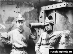 Red Army soldiers stand alongside an armored train used in the war.