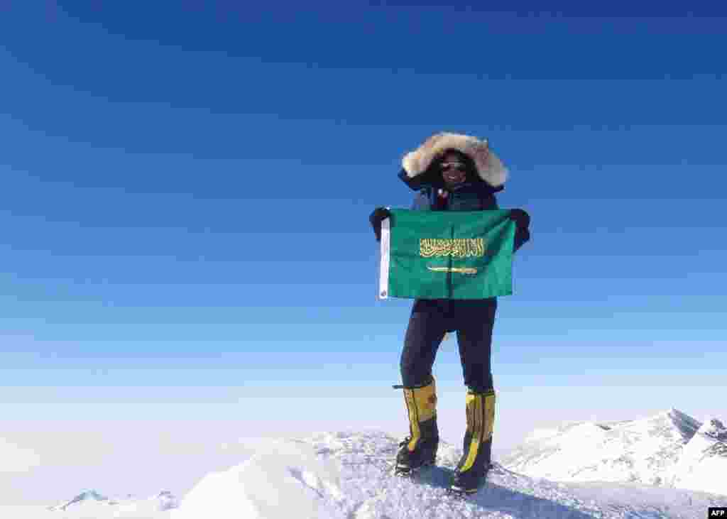 Saudi Arabian climber Raha Moharrak poses on Mount Everest on May 18, 2013. Moharrak is the first Saudi woman and the youngest Arab to climb the peak.