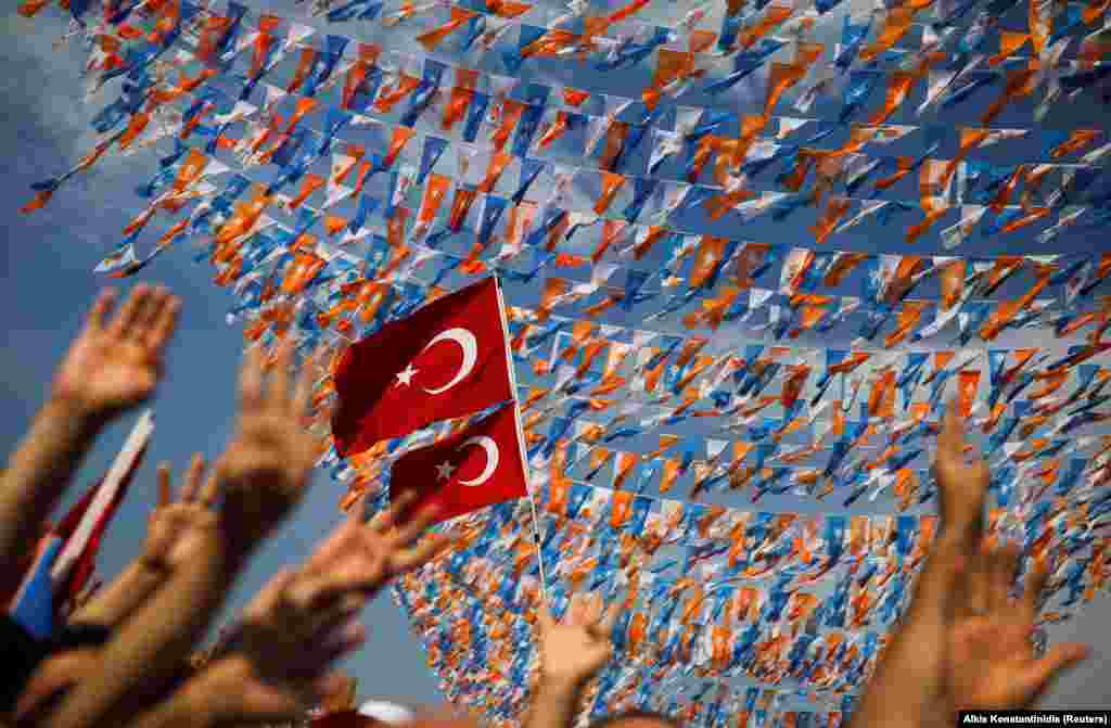 Supporters of Turkish President Tayyip Erdogan gesture as they attend an election rally in Istanbul on June 22. (Reuters/Alkis Konstantinidis)