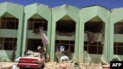 FILE: A government complex after a suicide bomb attack in Zabul.