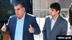 Tajik President Emomali Rahmon with his son Rustam (file photo)
