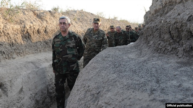 Nagorno-Karabakh - Armenian President Serzh Sarkisian walks through a frontline trench near Karabakh, 22Oct2012.