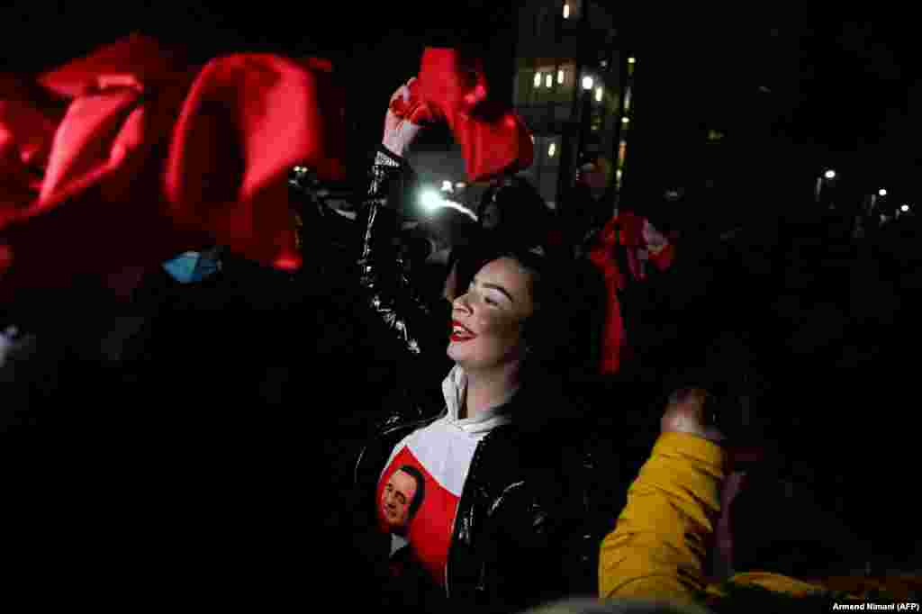 Supporters of Kosovo's Vetevendosje (Self-Determination) movement celebrate their victory in parliamentary elections in Pristina on February 14. (AFP/Armend Nimani)