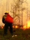 Firefighters work on a site of a forest fire in Yakutia in Russia Far East.