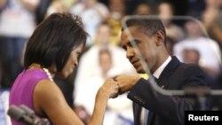 Мишель и Барак Обама празднуют победу на первичных выборах в Демократической партии США, Миннесота, 3 июня 2008 года