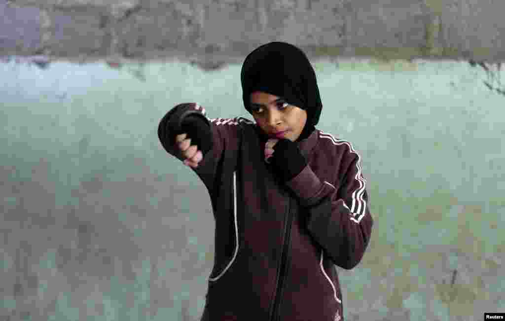 Misbah, 17, takes part in warm up exercises at the first women's boxing camp in Karachi, Pakistan, February 19, 2016. The opening of the school angered many in Pakistan who say that women have no place in sport.