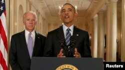 FILE PHOTO - Former US President Barack Obama delivers a statement about the nuclear deal reached between Iran and six major world powers with Vice President Joe Biden at his side, July 14, 2015