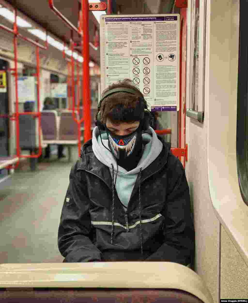 A man dozes in his face mask shortly before 8 a.m. on March 17.
