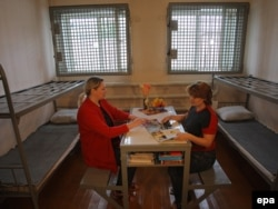 "Two women reading in their prison cell in an ""investigative isolation ward"" in Mozhaysk, near Moscow."