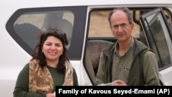 Iranian-Canadian professor Kavous Seyed-Emami and his wife Maryam Mombini in an unidentified location in Iran. FILE undated