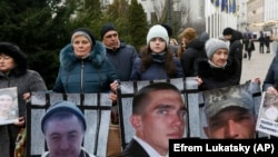 Relatives of Ukrainian prisoners held by the Russia-backed separatists display pictures of their loved in Kyiv in January.