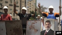 The Coptic cleric's killing comes against a backdrop of mounting bloodshed between supporters of ousted Egyptian President Muhammad Morsi and the military that displaced him.