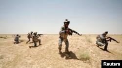 Pjesëtarë të forcave irakiane të sigurisë...