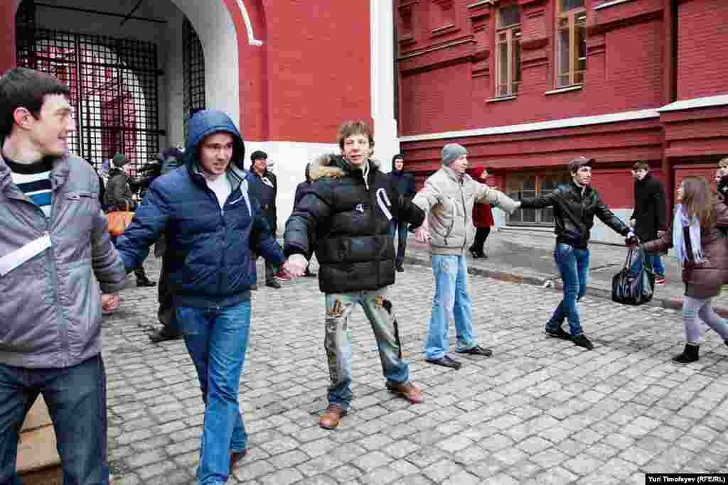 Opposition activists stand near the closed entrance to Red Square.