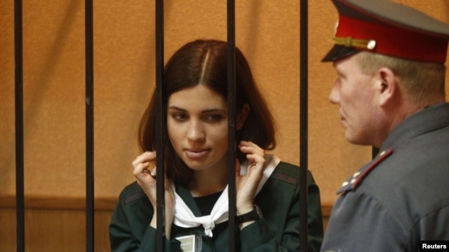 Pussy Riot member Nadezhda Tolokonnikova looks out from a holding cell during a court hearing in the town of Zubova Polyana on April 26.