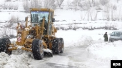 This file photo shows snow being cleared near the Salang Pass in 2008.