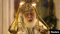 Georgian Patriarch Ilia II leads a midnight Christmas service at the Holy Trinity Cathedral in Tbilisi in January 2013.