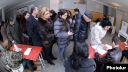 Armenia - Residents of Yerevan queue up at a polling station to vote in a presidential election, 18Feb2013.