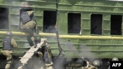Russian troops board a train during a training exercise.
