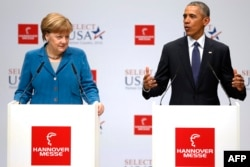 U.S. President Barack Obama (right) and German Chancellor Angela Merkel speak to the press as they tour the Hannover Industrial Fair on April 25.
