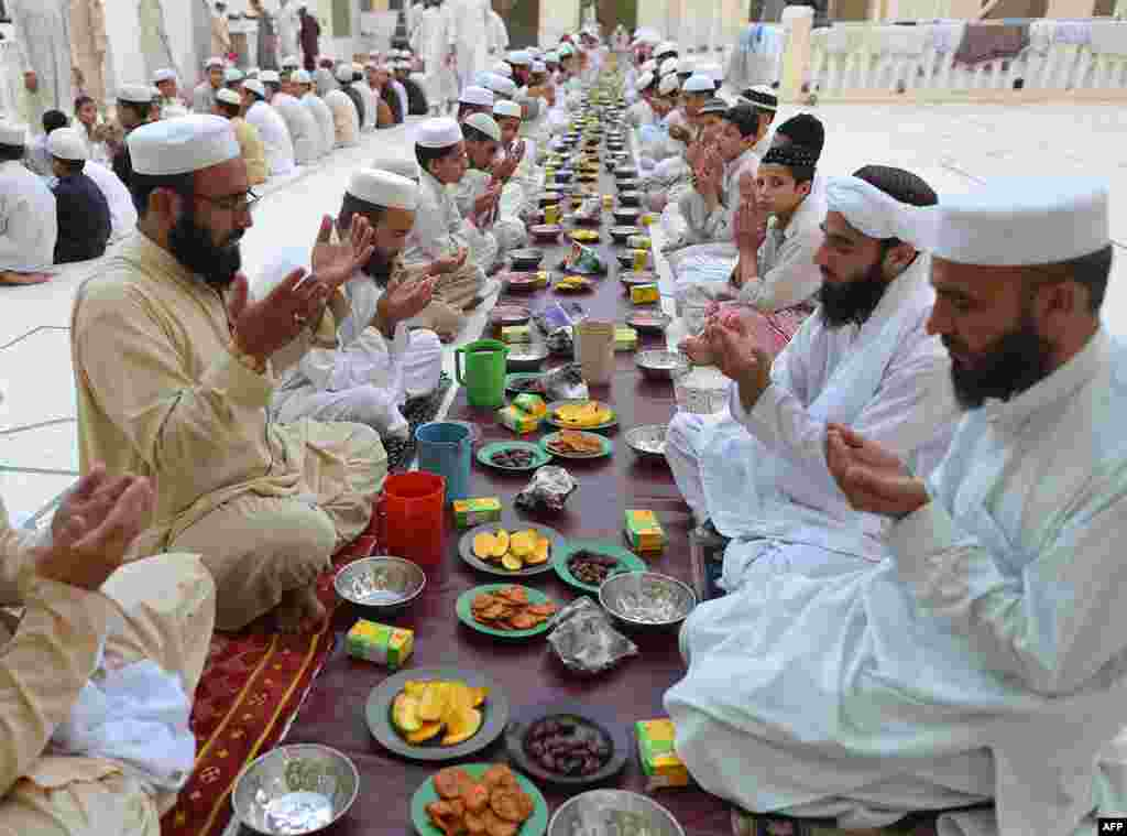 Pakistani Muslims pray before breaking their fast at a mosque during the first day of the Muslim fasting month of Ramadan in Peshawar on July 11. (AFP/A. Majeed)